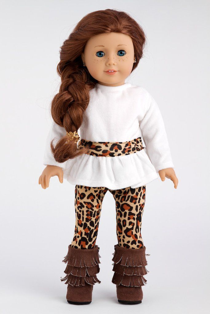Ivory velvet tunic with cheetah leggings and fringe boots. - Doll outfit contains a wide back closure for easy dressing and clothing removal. - Our doll clothes fits 18 inch American Girl dolls. - Des