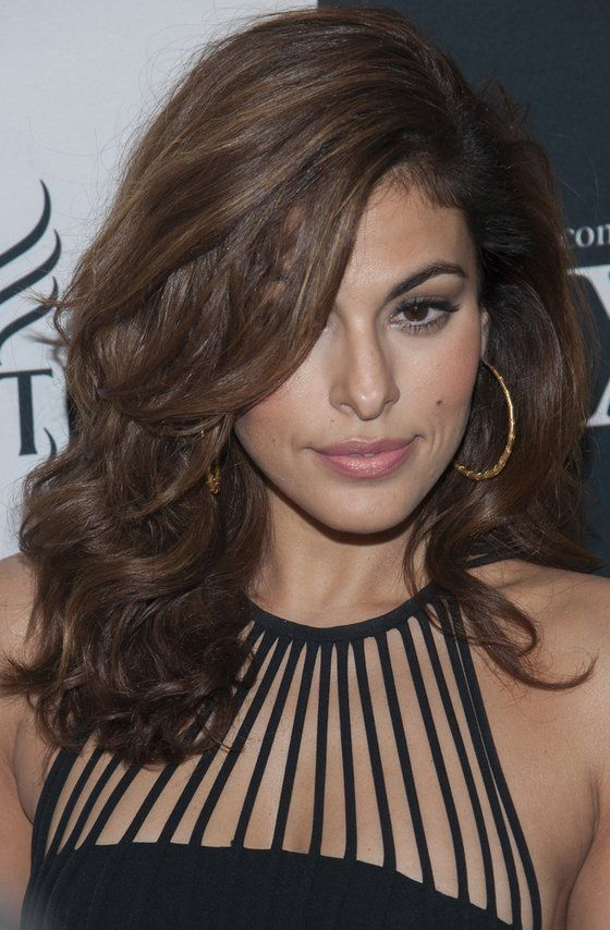 Eva Mendes hairstyle inspiration: side swept bangs, soft waves.