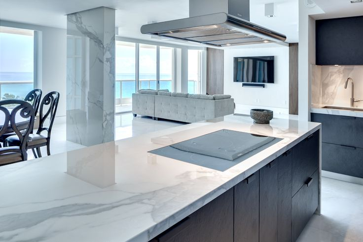 #Neolith, the main material in a luxurious apartment in Miami Beach. Neolith #Estatuario Polished in kitchen #countertop, island and column #cladding.
