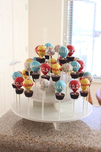 Hot Air Balloon Cake Pops on Round Cake Pop Stand: http://www.thesmartbaker.com/products/3-Tier-Square-Cake-Pop-Stand.html