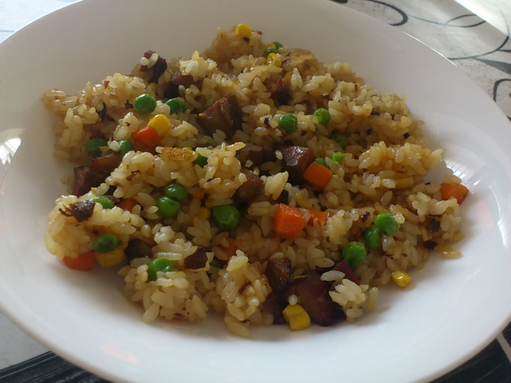 a fried rice with vegies and barbecued pork