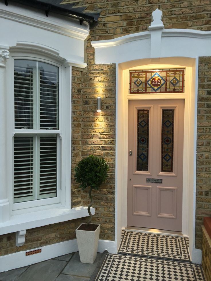 Outside view of a Stunning original Victorian stained glass door supplied from Strippadoor Stockport and fitted in London by qsdevolpments. National and international delivery available. Please send sizes over for a quote Info@periodhomestyle.co.uk Periodhomestyle.co.uk Any size can be done and colours can be changed to suit. 0161 477 8980