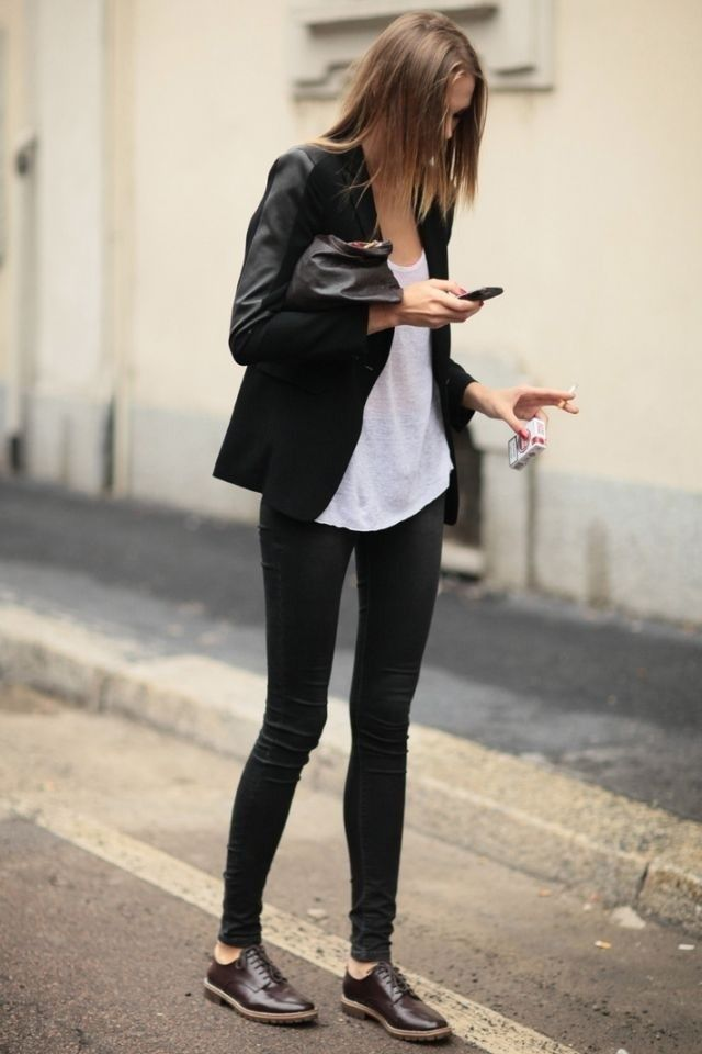 Shop this look on Lookastic:  http://lookastic.com/women/looks/oxford-shoes-leggings-blazer-clutch-tank/4902  — Dark Brown Leather Oxford Shoes  — Black Leggings  — Black Blazer  — Black Leather Clutch  — White Tank
