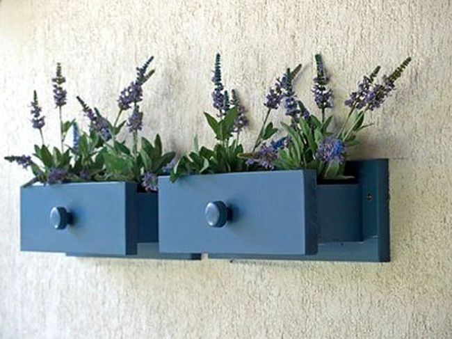 Repurpose drawers as wall planter accents.