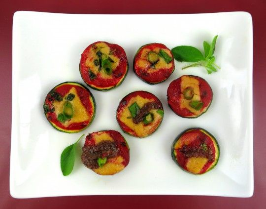 Zucchini Pizza Bites are fun to make and fun to eat, Zucchini Pizza Bites are a delightful appetizer, party food, snack or side dish. It's a simple pizza on a zucchini slice, but people go crazy for this delicious treat. The recipe is truly Paleo, Vegan, and Nightshade-free. #paleo #pizza