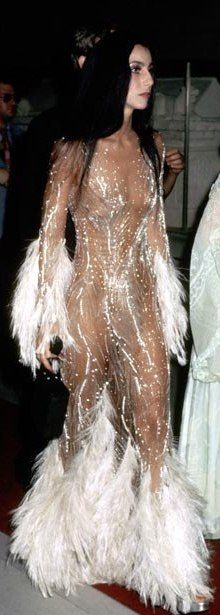 """Fashion slide show of Cher's various looks: Cher's One-of-a-Kind Fashion Legacy By Christopher Barnard As Bob Mackie once said of his muse and client, """"She was like a big Barbie doll."""" If Barbie favored four-foot-high feather headdresses, that is. In honor of her new movie, Burlesque, we tick off Cher's most memorable fashion moments. Plus: Cher on Chaz, Sonny, and Staying in the Spotlight,"""