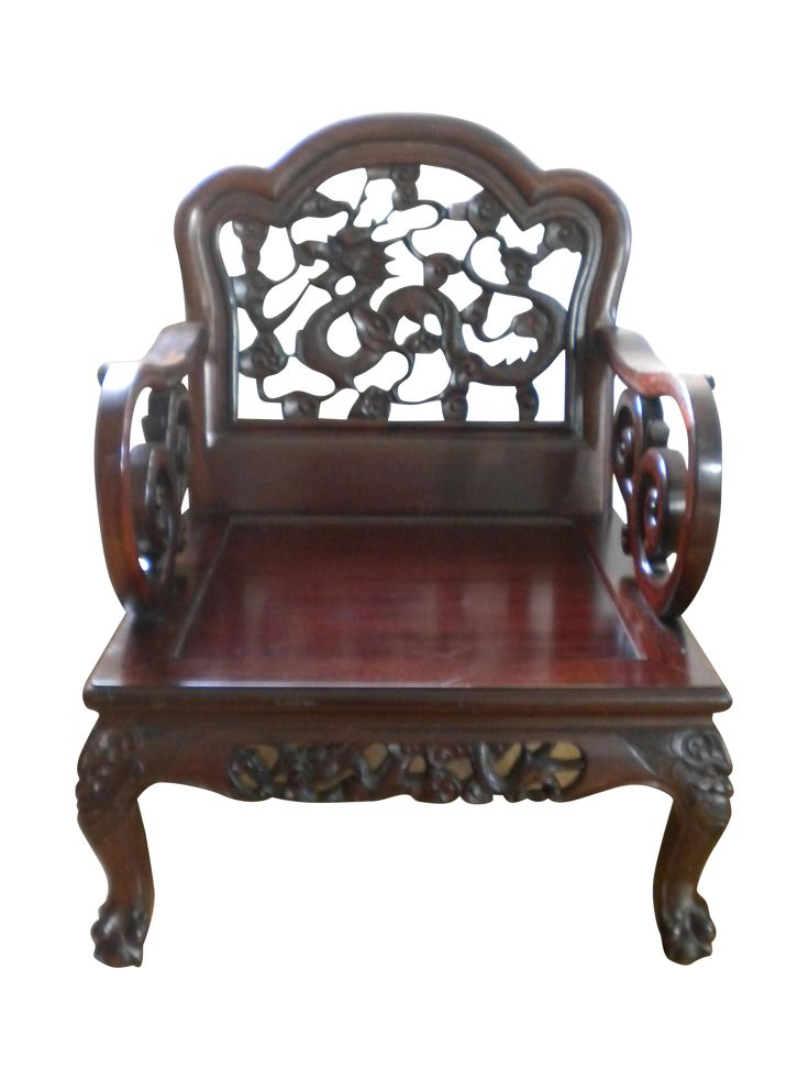 The seller says: This unique chair has been in my family for many years.  It is solid wood, perhaps mahogany.  There is a definite dragon theme to this chair:  the back of the chair has a detailed carving of a Chinese dragon which is equally beautiful from the front and the back.  Each side panel of the chair also has a hand-carved dragon and each leg has the face of some kind of sprite-perhaps human, perhaps animal.  The seat of the chair is rather wide and deep-I have a dense foam cushion…