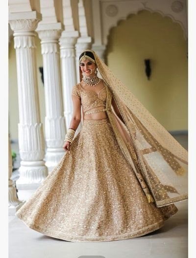 Bridal Lehenga - Sequinned Gold Lehenga | WedMeGood   #wedmegood #bridallehenga #weddinglehenga #bridal #gold #sequinned #lehenga #bridal #net #bridalwear #indianwedding