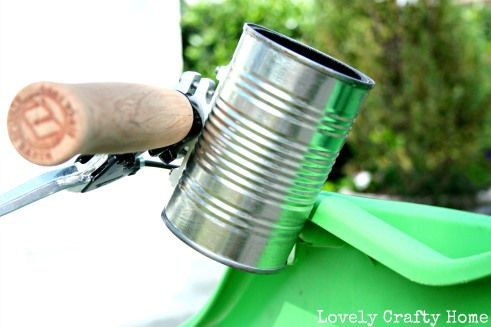 DIY bike cup-holder: Can + Koozie + Bike mount Fits coffee tumbler, beer bottle, water bottle, and coke cans. I'd even paint it Orange! (though I love the look of the can)