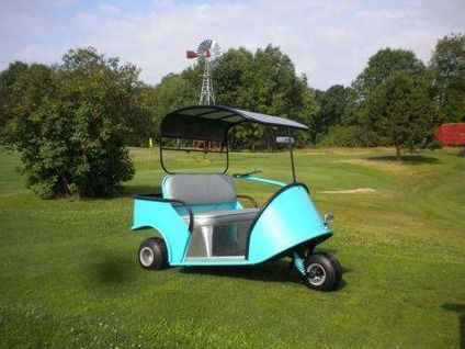$3,500 1950's electric marketeer golf cart Rufus and Gerald tour the Gainsworthy estate in the tour cart