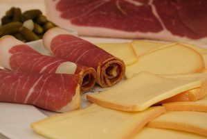 Melt raclette cheese slices in the oven and serve it over a variety of meats and vegetables.