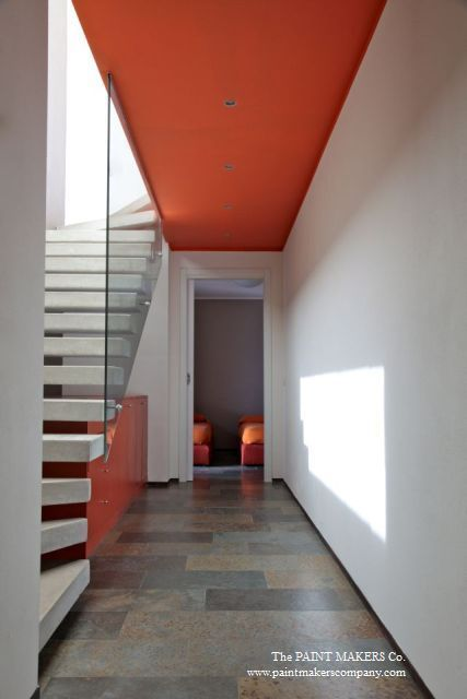 The orange ceiling leads to the kids' room adding a personal touch to this white corridor. Ceiling painted in Keith Orange by The Paint Makers Co.