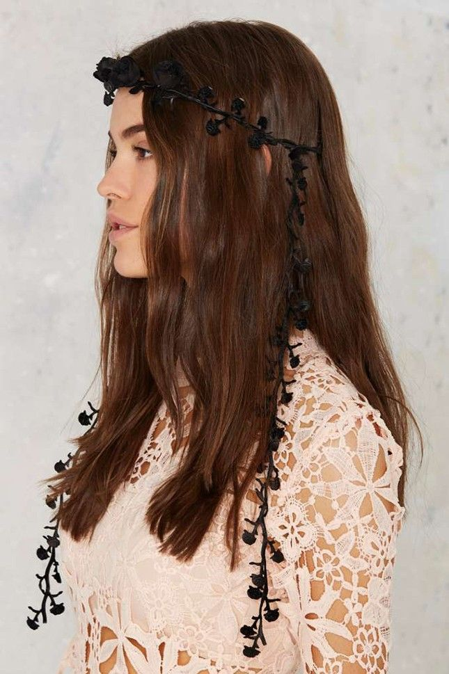 Cross over to the dark side with a floral crown that's fit for a bride.