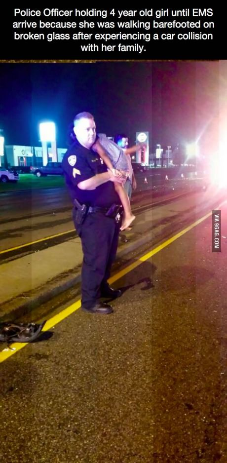 Police Officer holding 4 year old girl until EMS arrive because...