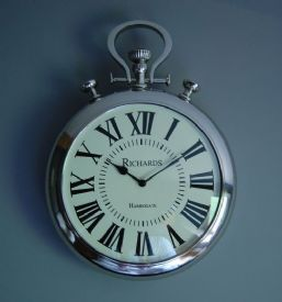 This oversized stopwatch wall clock is a favourite, available in 2 sizes. This large kitchen wall clock has a classic, stylish design makes reading the time a pleasure as well making a statement. This big wall clock measures H53xW38xD9cm.
