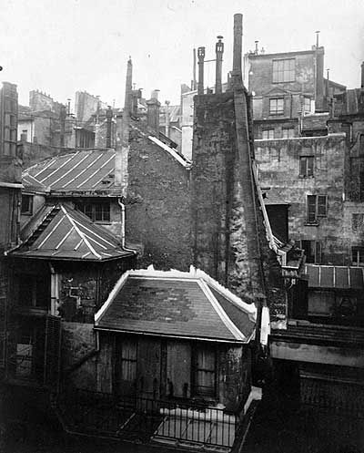 Eugène Atget,  Paris. Eugène Atget was a French flaneur and a pioneer of documentary photography, noted for his determination to document all of the architecture and street scenes of Paris before their disappearance to modernization..