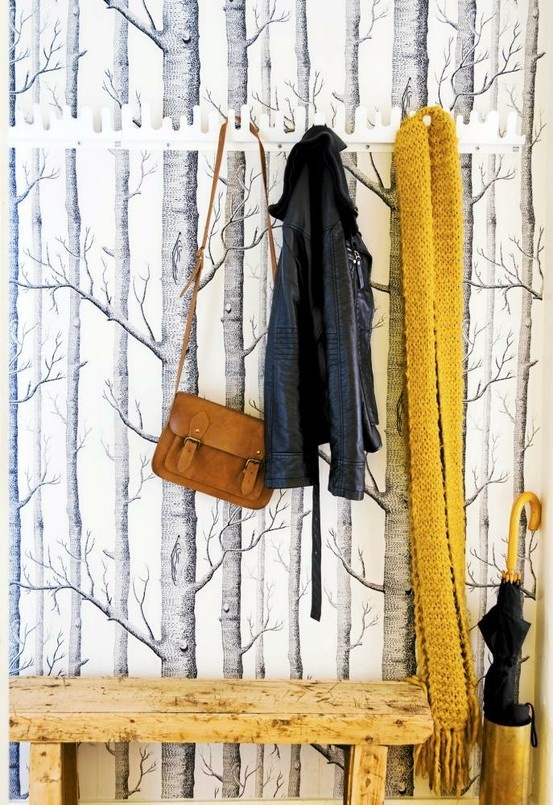Use forest wall paper and add natural branches for hooks and natural wooden bench for entry way...