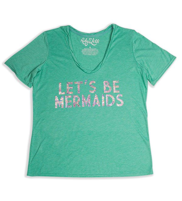 """I must be a mermaid, I have no fear of depths and a great fear of shallow living. – Anais Nin  Bring out your inner Mermaid with our stunning """"Let's Be Mermaids"""" tee. Our rainbow foil print is like the mystical scales of a mermaid's tale, or the inside of a beautiful seashell.  Heathered Sea Glass  Oyster Shell Foil Print  Vintage Feel Cotton Blend  Round Neckline  Relaxed Fit  Ruby & Lilli Size S (10) to 5X (26)"""
