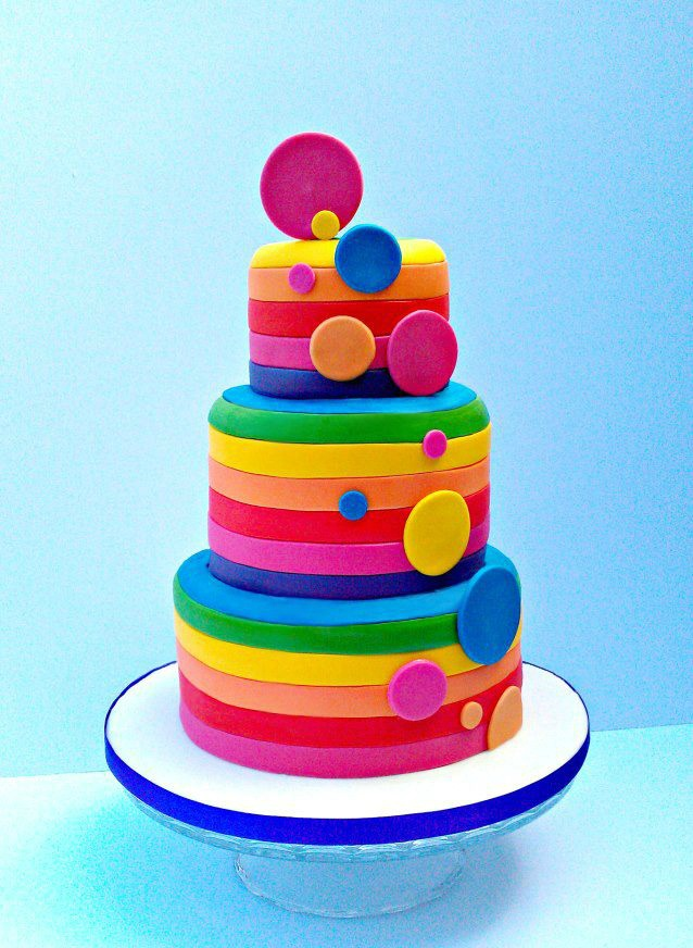 Bright spotty rainbow stripe cake - ideal for a funky occasion that needs a unique centrepiece!
