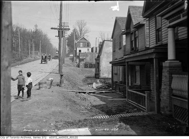 'April 24, 1913. 1471-1475 Dufferin Street.' Interesting how road grading has left these houses 'below grade' as it were. Also interesting is the plank sidewalk.