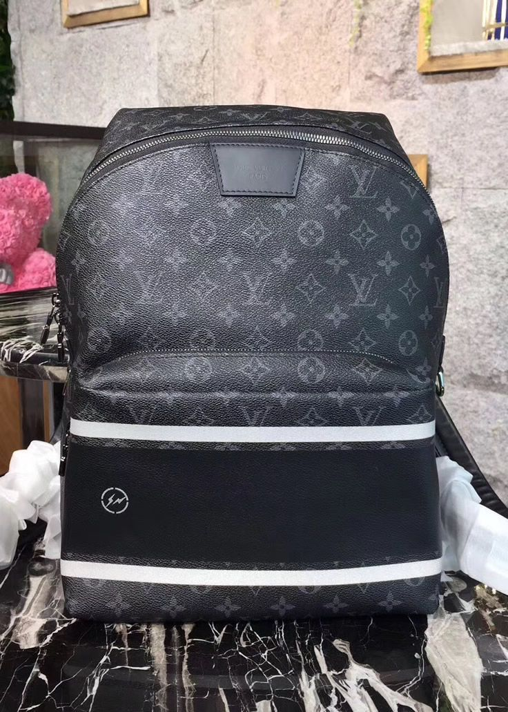 9b03059ed8f The Louis Vuitton Monogram Eclipse Apollo Backpack looks special