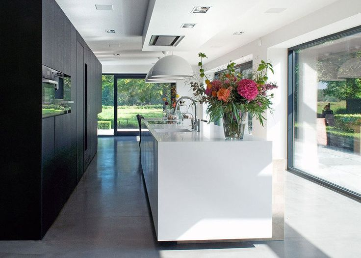 1960s Dutch House Went to the Dark Side and It's Glorious - Renovations - Curbed National rang hood in the bulkhead