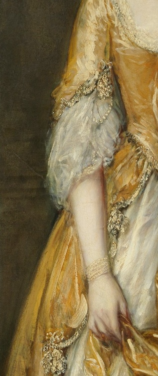 Apricot gold silk open robe gown embroidered lace, fly fringe and pearls trim, and petticoat of cream silk. Complemented with pearl strand bracelets on both wrists. Detail from portrait of Mrs. Grace Dalrymple Elliott (1754?–1823), 1778, Thomas Gainsborough. (c) Metropolitan Museum of Art