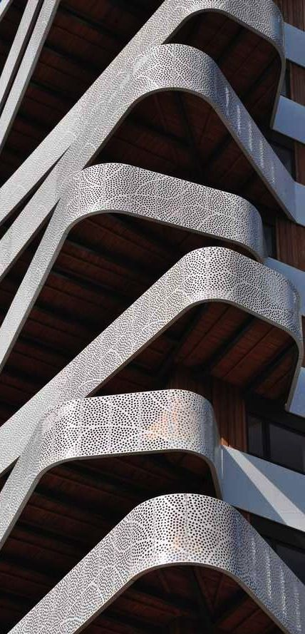 Perforated metal balconies, Hatert Housing, Nijmegen, The Netherlands by 24H architecture