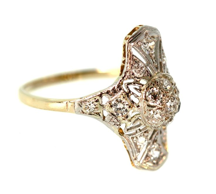 This north south style diamond filigree ring sparkles with 0.28 carats in Old European cut diamonds set in this lovely platinum topped gold setting.