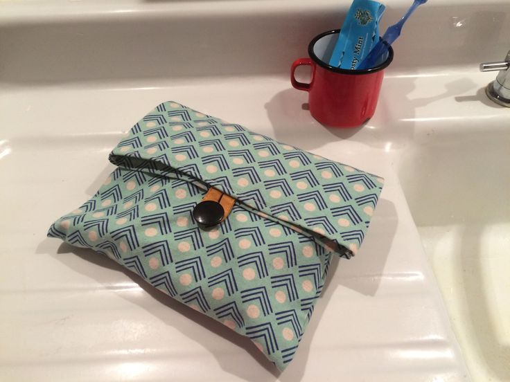 Handmade modern blue canvas toiletry bag.  https://www.etsy.com/ca/your/shops/scraphilldesigns