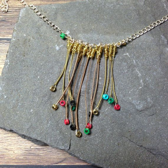 Gold Tribal Style Guitar String Necklace Guitar String Jewelry by LuckyStrings  I wonder if I can find some of my Dad's old guitar strings.