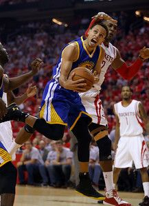 Description of . Golden State Warriors\' Stephen Curry (30) takes a shot against Houston Rockets\' Dwight Howard (12) in the second quarter of Game 3 of the NBA Western Conference finals at the Toyota Center in Houston, Texas, on Saturday, May 23, 2015.  (Nhat V. Meyer/Bay Area News Group)