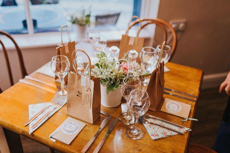 Simple but elegant table arrangements for an intimate wedding breakfast. Photo by Benjamin Stuart Photography #weddingphotography #tabledecor #weddingbreakfast #flowers #letseat #gingerskitchen #weddingday #dinnerdecor
