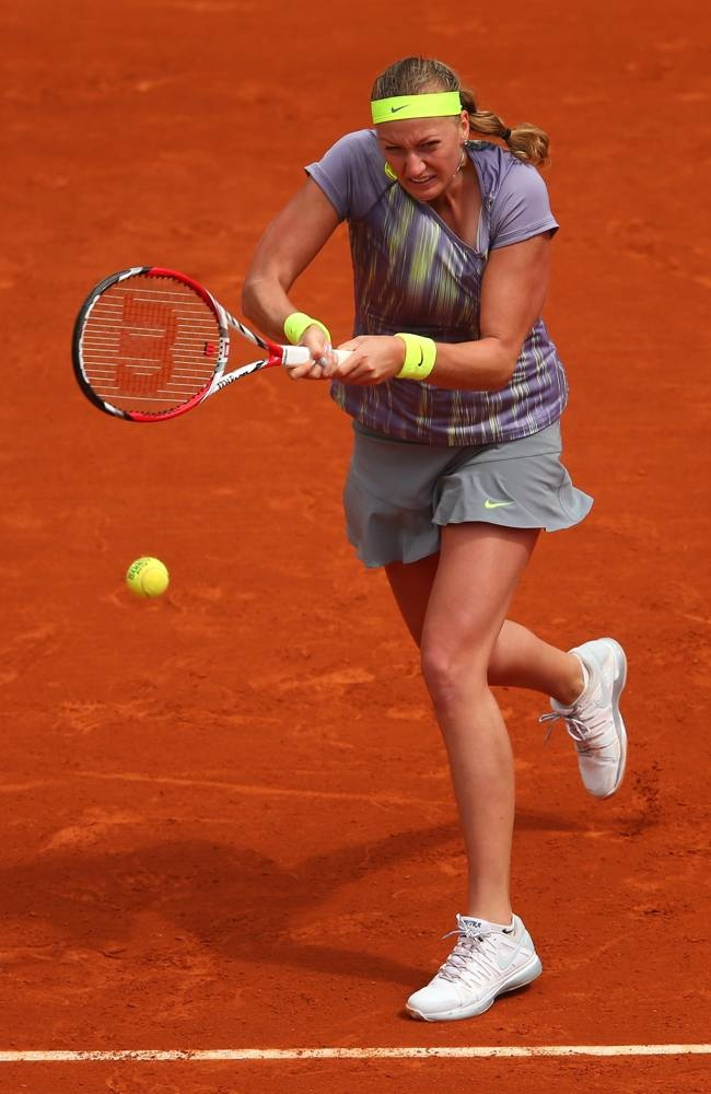 Petra Kvitova of Czech Republic plays a backhand in her Women's Singles match against Aravane Rezai of France during day four of the French Open at Roland Garros on May 29, 2013 in Paris, France. (Photo by Julian Finney/Getty Images)