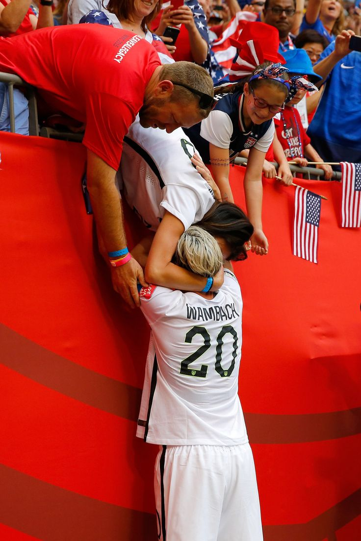 Abby Wambach embraces wife Sarah Huffman after winning the World Cup Final.