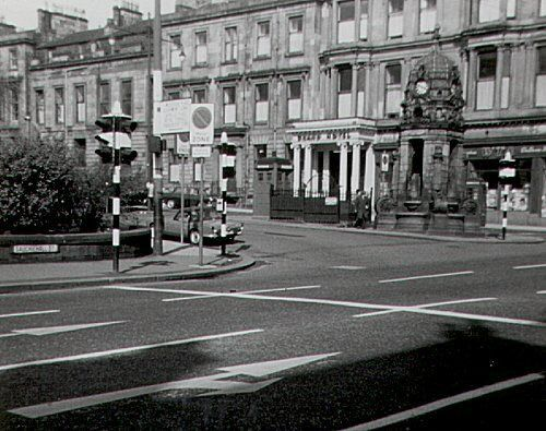 A view of Woodside Crescent from Sauchiehall Street in 1966. A side entrance to the Grand Hotel can be seen behind the Cameron Memorial Fountain, which still stands today. Picture: Gerald England