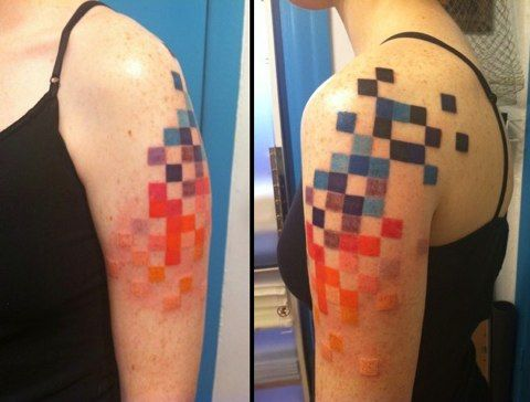 love this modern take on tattooing. This would be made even better if the pixels formed an image when squinting or viewed from a distance