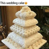 Ivory pillow wedding cake.