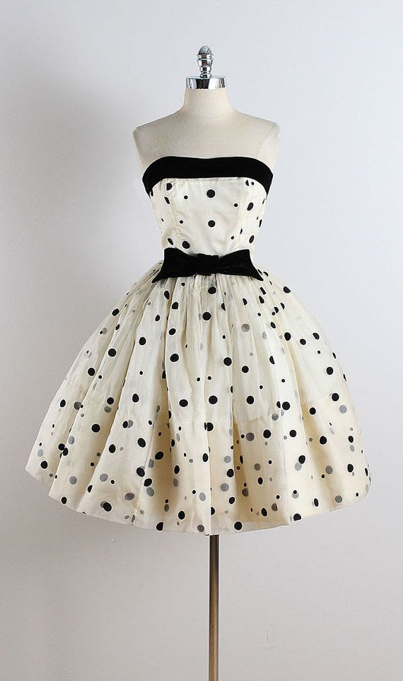 ➳ vintage 1950s dress  * ivory organza * acetate & tulle lining * black polka dot print * black velvet bow and bodice accent * bodice stays * metal side zipper  condition | excellent  fits like xs/s  length 34 bodice 10 bust 34 waist 25 hem allowance 5  ➳ shop http://www.etsy.com/shop/millstreetvintage?ref=si_shop  ➳ shop policies http://www.etsy.com/shop/millstreetvintage/policy  twitter | MillStVintage facebook | millstreetvintage instagram | millstreetvintage  5724/1619