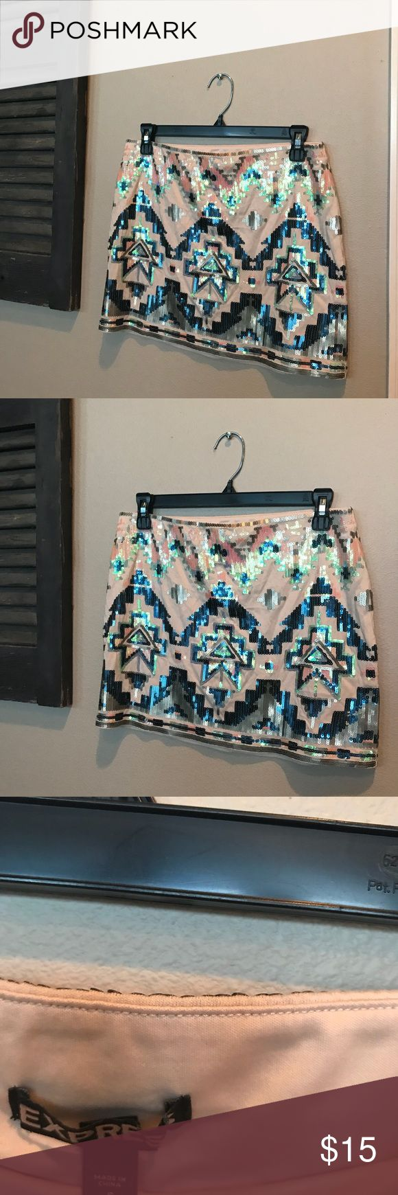 Perfect for VEGAS!! Express Aztec sequin skirt Mini skirt, only been worn twice, looks great with a grey t-shirt, blue denim long sleeve shirt or a white blouse. Express Skirts Mini