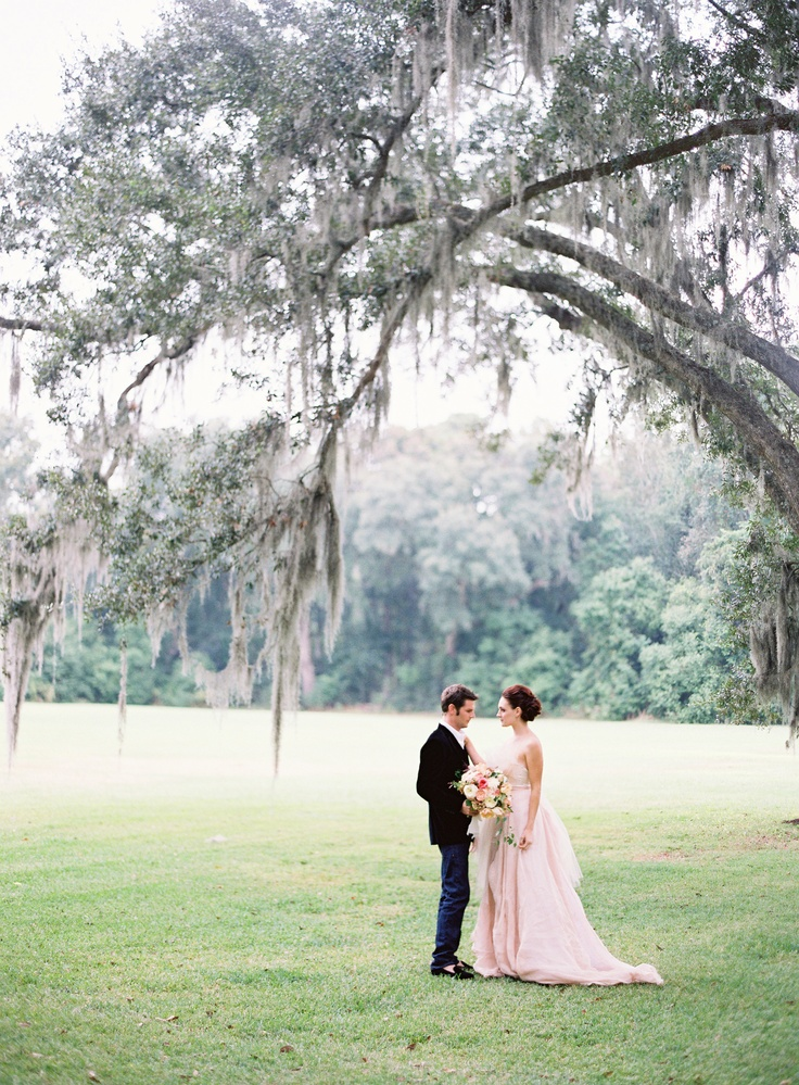 Lovely Couple, suiting by Grady Ervin and wedding gown by @Carol Hannah Whitfield, Easton Events at Fenwick Hall in Charleston, Photography by @jose villa