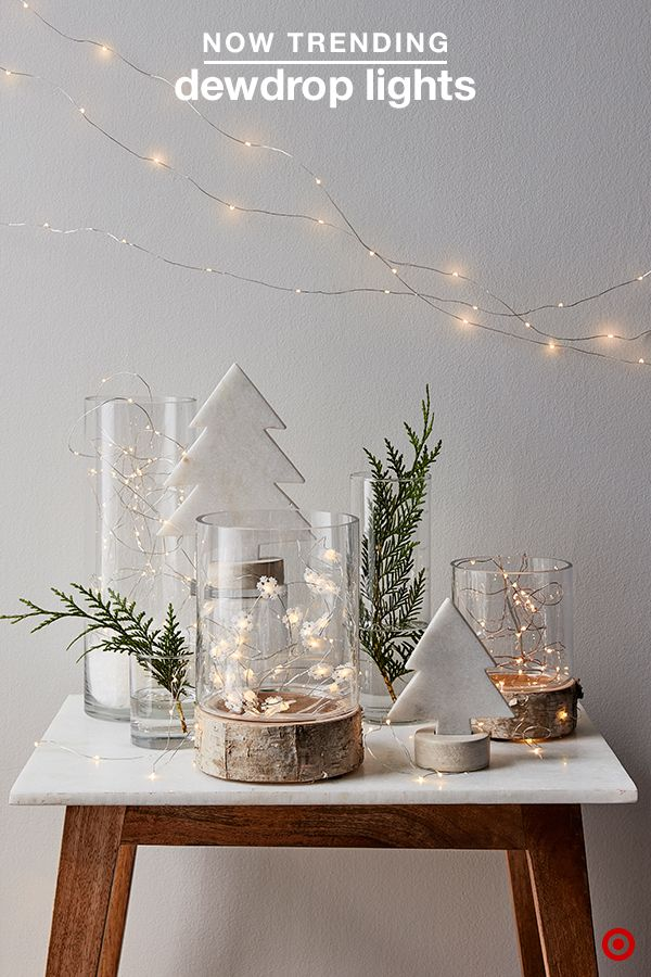 Create a magical ambiance this Christmas with décor pieces that add warmth and elegance to your space. Try mixing rustic, warm woods with sleek, cool marble and glass elements to strike the perfect balance. Add whimsy with dewdrop lights—they provide a soft, twinkling glow in hurricanes, around wreaths, along the mantel or as decorative strands.