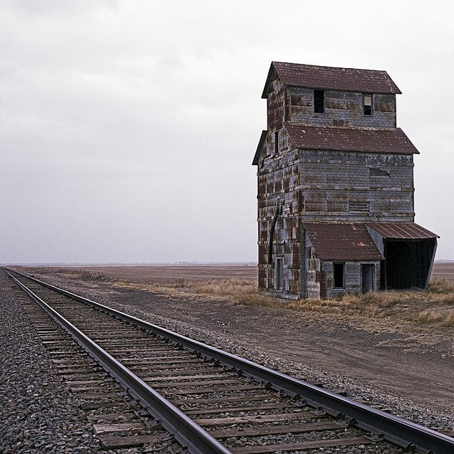 """Abandoned place along railroad tracks in Kansas"""