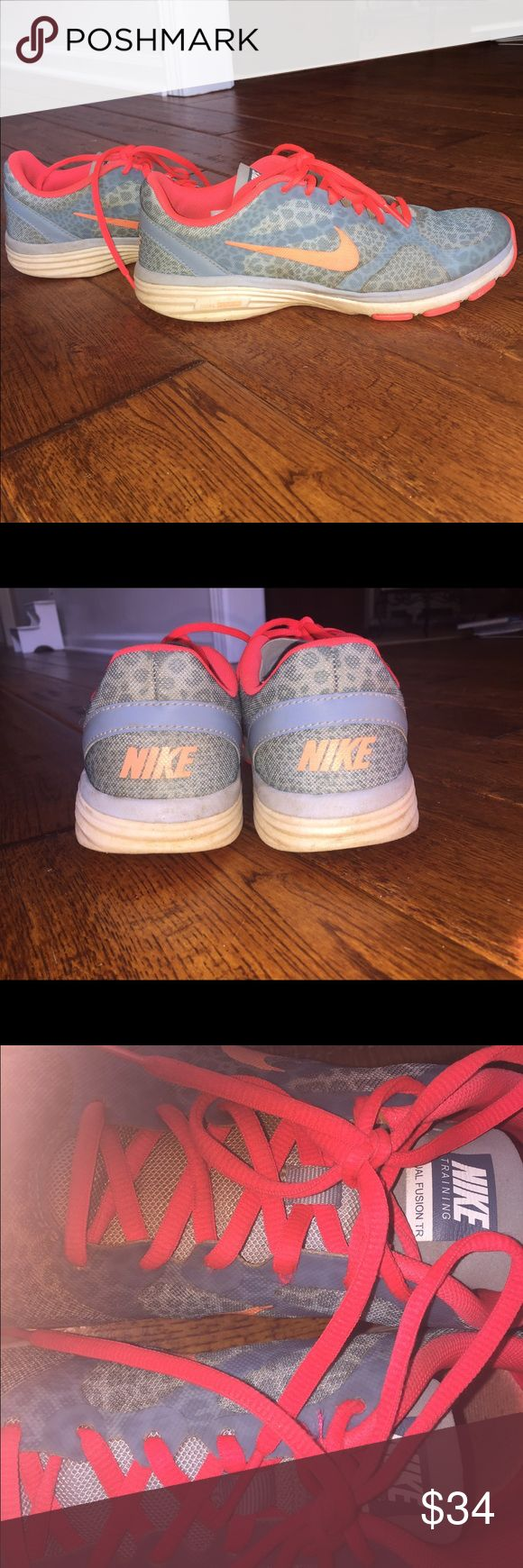 Nike tennis shoes women's 7.5 Nike women's sz 7.5 tennis shoes. Blue and coral. Great condition. Feel free to ask questions and make offers! Nike Shoes Athletic Shoes