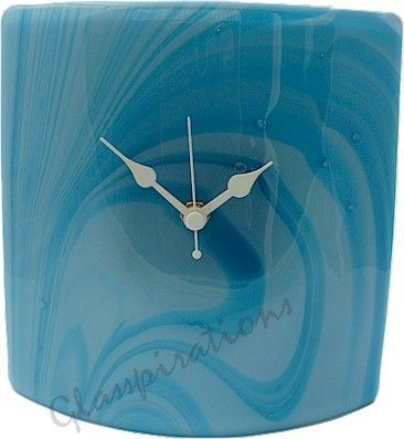 A new creation in the Glasspiration's range of mantel clocks. Gently moulded into a slight curve and capped with clear glass creating tiny bubbles during the fusing process.  Size: 20cm Wide X 16cm High  £45.00