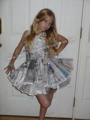 Recycled Newspaper Costume: About one month before Halloween my little sister presented me with a challenge. She wanted a dress made from newspaper. I immediately fell in love with