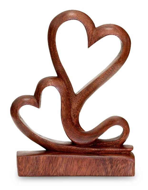 Features: -Suar wood. -Two hearts. -Each artwork is unique. Product Type: -Sculpture. Style: -Modern. Subject: -Abstract and shapes. Finish: -Brown. Primary Material: -Wood. Dimensions: Overa