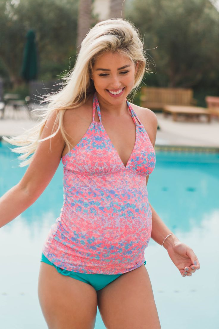 Splash into style with this amazing abstract print maternity tankini top. This tankini top features a triangle, halter top and ruched sided that will flatter your growing baby belly. Pair with a solid maternity bikini bottom, a flowy skirt, and strappy sandals for a complete look.