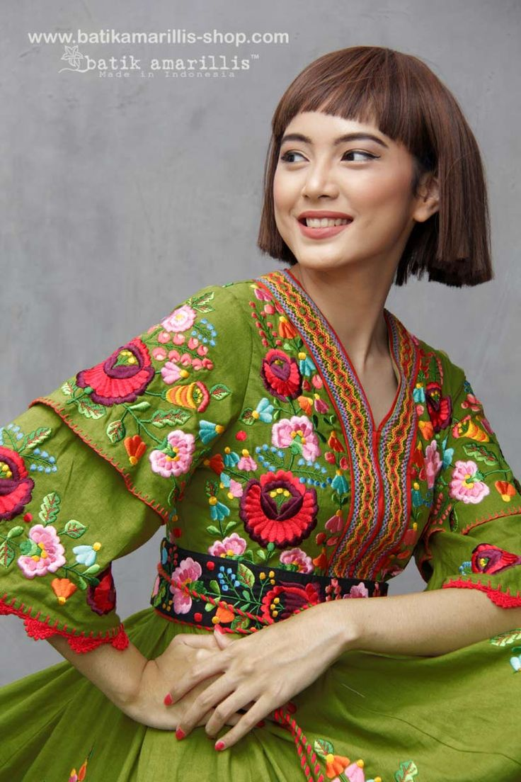 Batik Amarillis made in Indonesia www.batikamarillis-shop.com proudly presents batik amarillis's amarantha dress in full Hungarian embroidery inspired on deep lime green cotton linen blend also features beautiful Smocked neckline and waistband plus gorgeous crocheted around the sleeves , We maintain its distinct modern-bohemia, modest & unabashedly romantic. slimming silhouette with its tiered bell sleeves plus full skirt for ethereal head-turning approach to occasion dressing