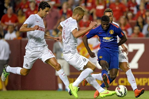 Wilfried Zaha #29 of Manchester United shoots as he is defended by Inter Milan players in the second half during their match in the International Champions Cup 2014 at FedExField on July 29, 2014 in Landover, Maryland. Manchester United won, 5-3, in a penalty shootout.